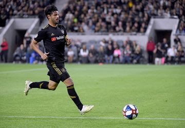 LAFC's Carlos Vela chases down a ball during a match on April 13.