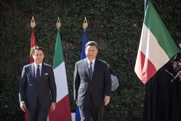 Xi Jinping, right, and Giuseppe Conte arrive for the signing of the memorandum of understanding on China's Belt and Road Initiative in Rome, on March 23.